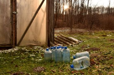 Full and Empty Water Bottles in front of Greenhouse. Winter. Short Hellos & Long Goodbyes. LipnicaTuzla, BiH. 2017 © Trashbus ǀ Renata Britvec