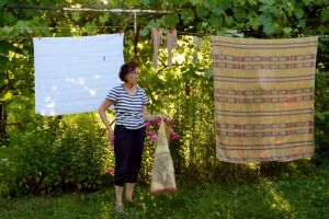 Mother in front of Clothesline. Short Hellos & Long Goodbyes. LipnicaTuzla, BiH. 2017 © Trashbus ǀ Renata Britvec